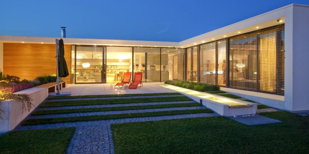 Casa parter moderna polonia arhipura for Design casa low cost