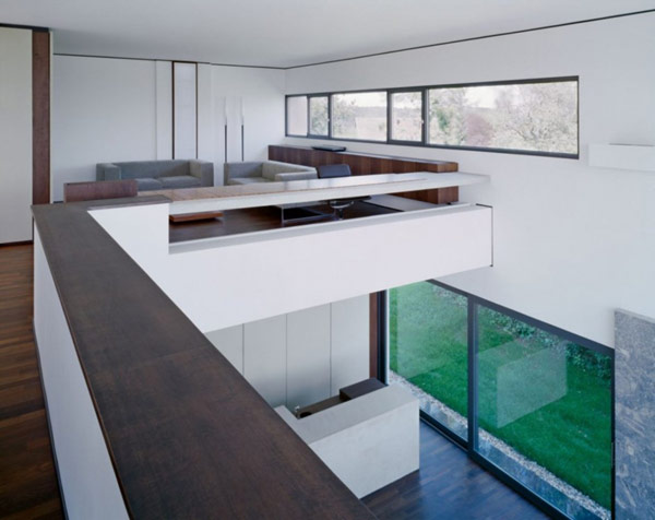 interior-third-floor-workspace-office-sofa-wooden-floor-large-window-green-grass-long-Chest-of-Drawer-glass-door