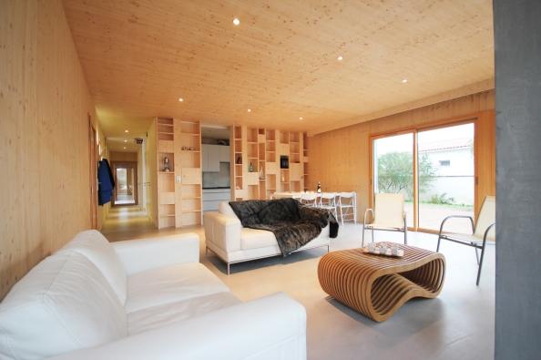 54a348f5e58ece7009000008_2-en-1-intergenerational-house-tica-architecture_2en1_living_room_dwelling_1