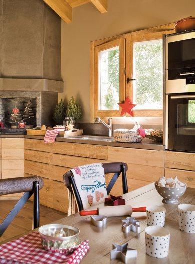cocina_navidena_con_muebles_en_color_madera_y_revestimiento_en_microcemento_945x1280